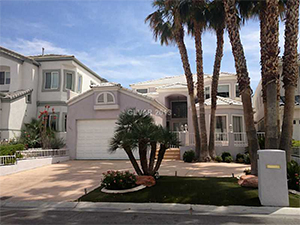 Discreet Short Sale Henderson House with Garage and Palm Trees